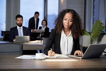 ethnic-businesswoman-working-in-modern-o