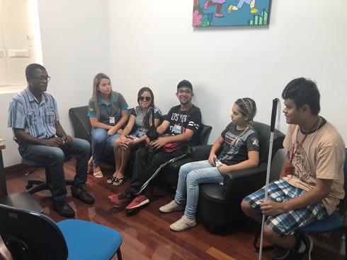 Foto de reunião entre colaboradores da ASAC