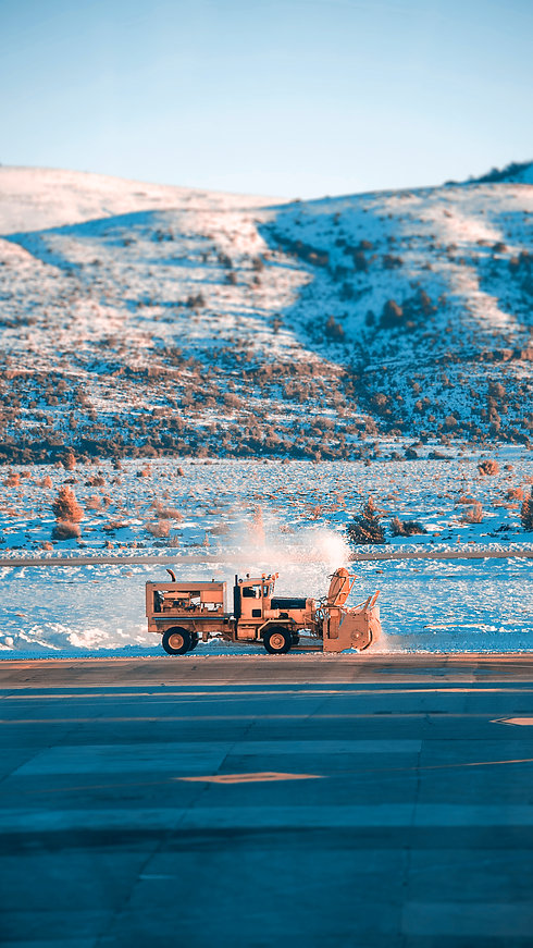 photo-of-yellow-truck-beside-road-326957