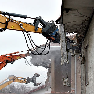 tractor%20destroying%20building_edited.jpg