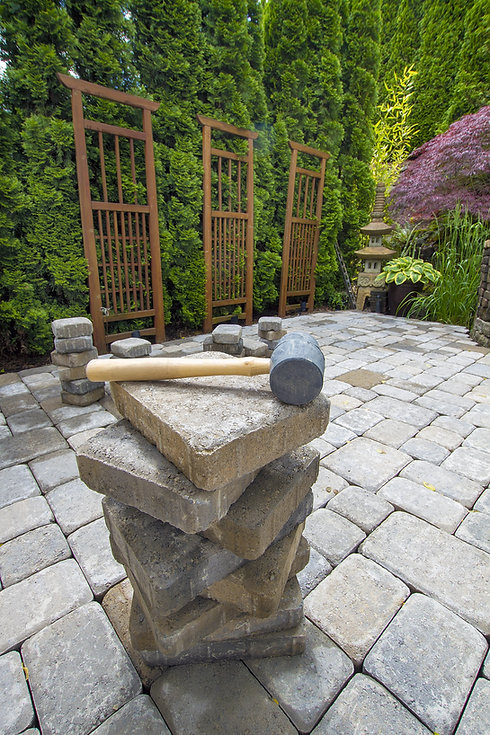 Stack of Cement Pavers On Backyard Patio