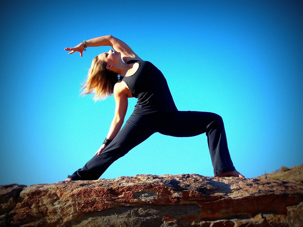 boost and increase your personal power, woman doing strong yoga pose against blue sky, image by jesslef