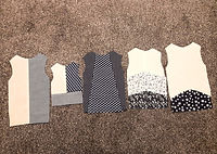 A variety of student samples of vests and bodices from upcycled materials.