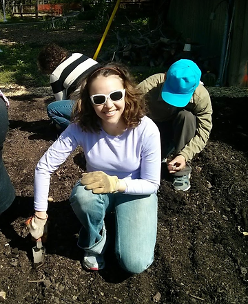 Maira volunteering at Parkhome Community Garden's planting day, Spring of 2014