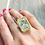 Thumbnail: Huge Bezel Set Emerald Cut Blue Stone Brushed Gold Ring