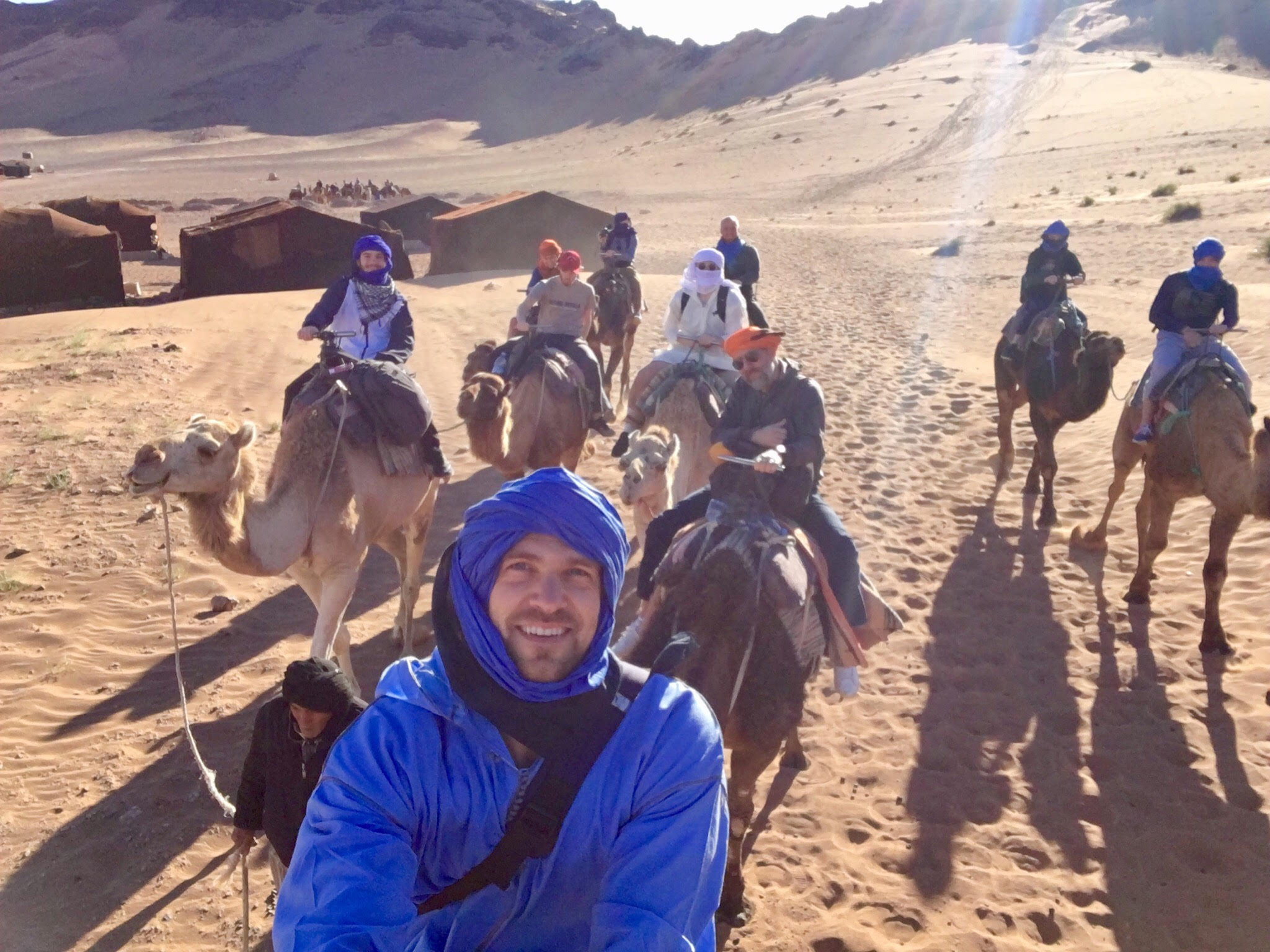 Riding camels through the desert