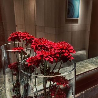 Red flowers on hotel nightstand