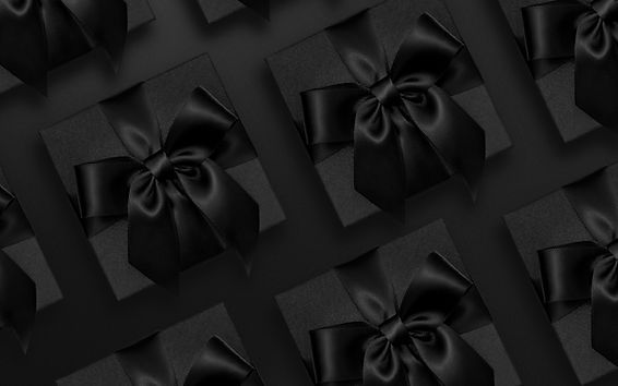 Black gift flat lay banner.jpg
