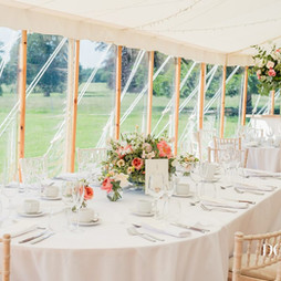 Oval top table in a sailcloth marquee.jp