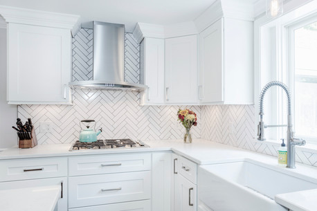 custom designed kitchen with herringbone subway tile backsplash
