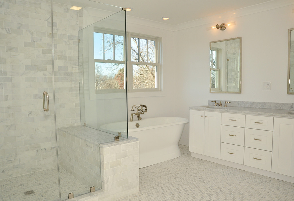 master bath with walk-in shower and soaking tub