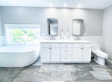 master bathroom featuring a soaking tub