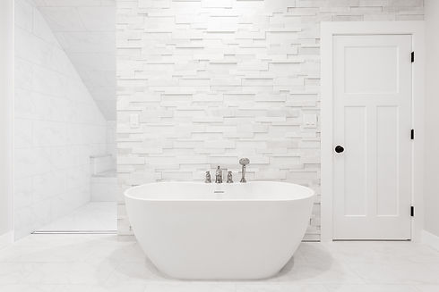 soaking tub with stone feature wall in master bathroom