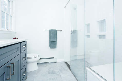 master bathroom featuring heated floors and walk in shower