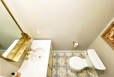 small powder room with brushed gold accents