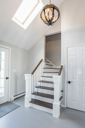 staircase with farmhouse chandelier