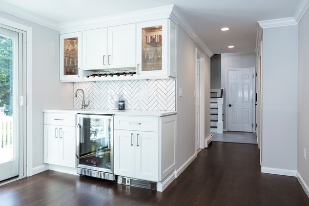 custom wet bar with herringbone backsplash