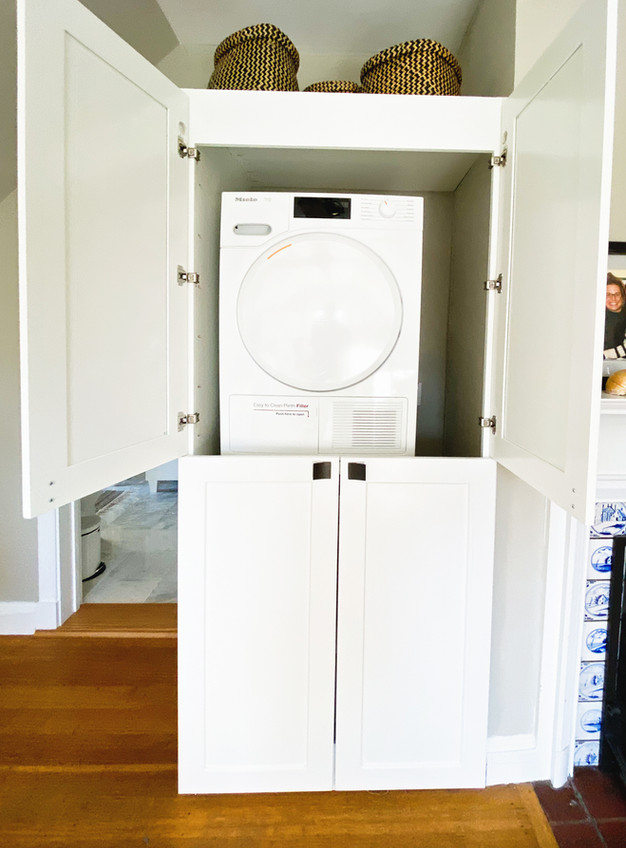custom built laundry cabinet