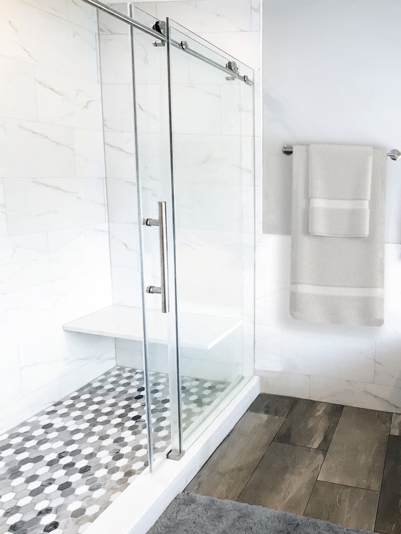 master bathroom walk-in shower with glass sliding door