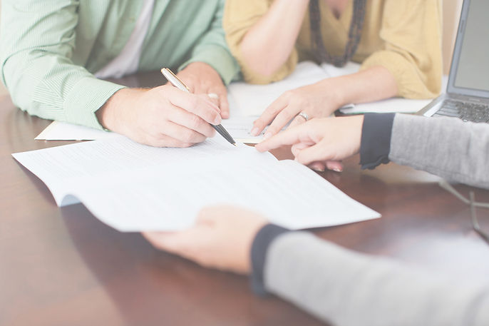 clients signing a real estate contract