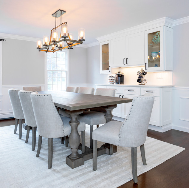 renovated dining room with farmhouse chandelier