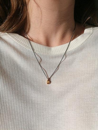 Gold pendant with rutilated quartz