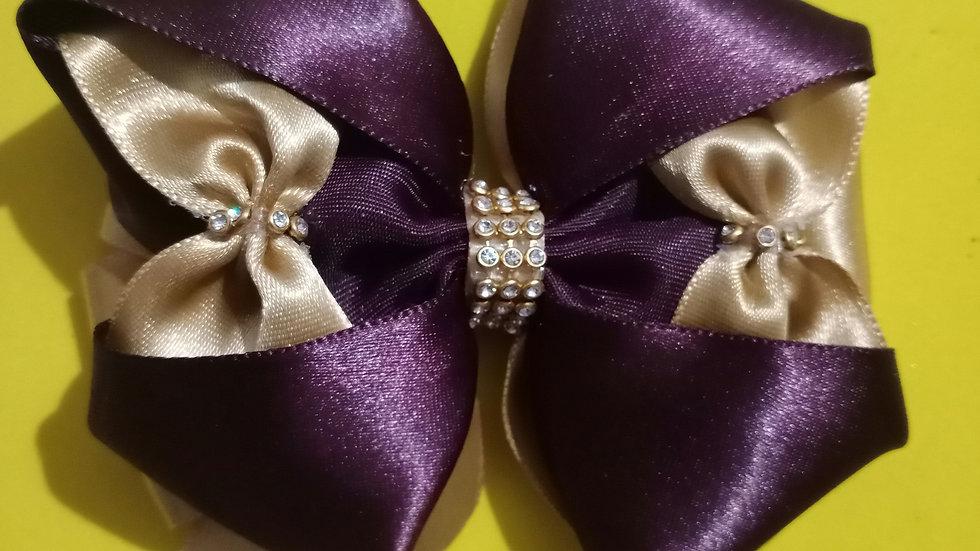 Dark wine and golden ribbon bow