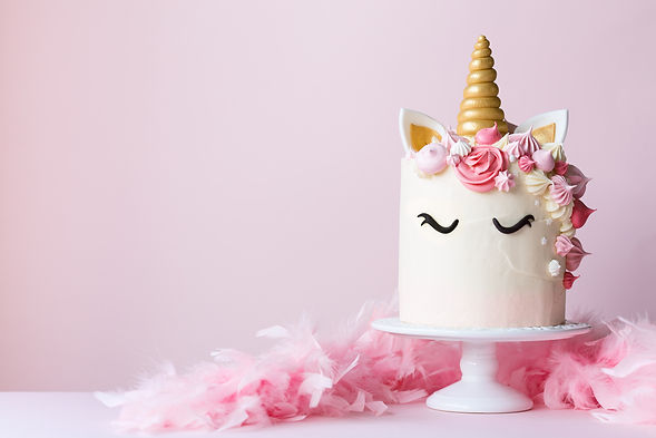Unicorn cake with pink frosting and copy