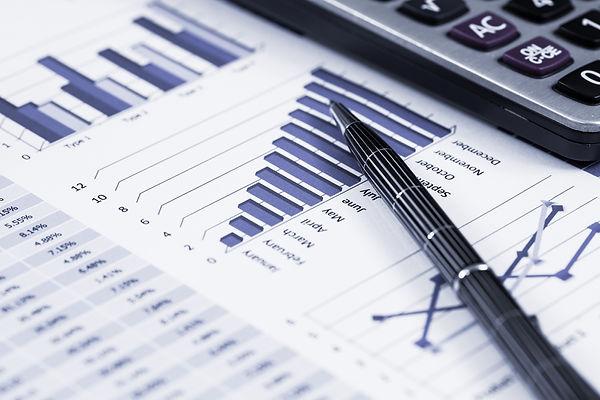 Graphs, pens, figures, calculator, management accounts