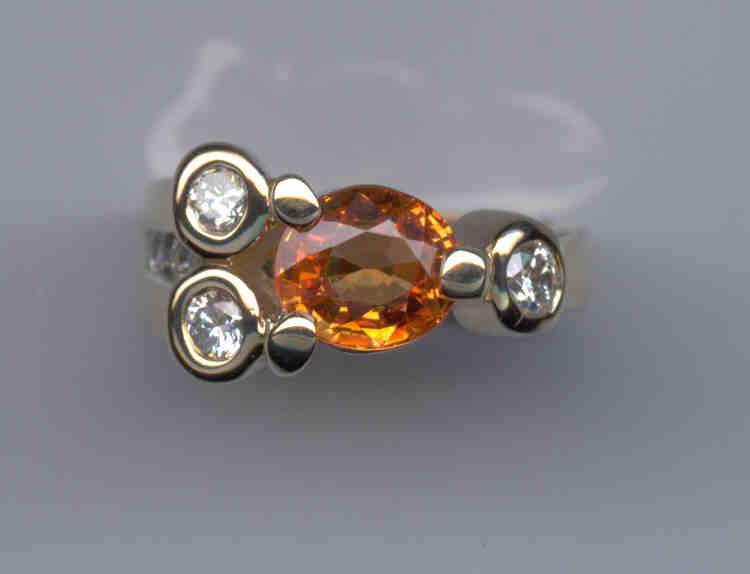 Orange sapphire and diamonds