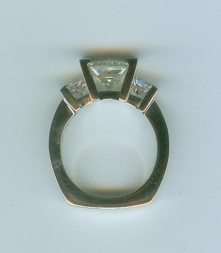 Princess cut three stone ring side