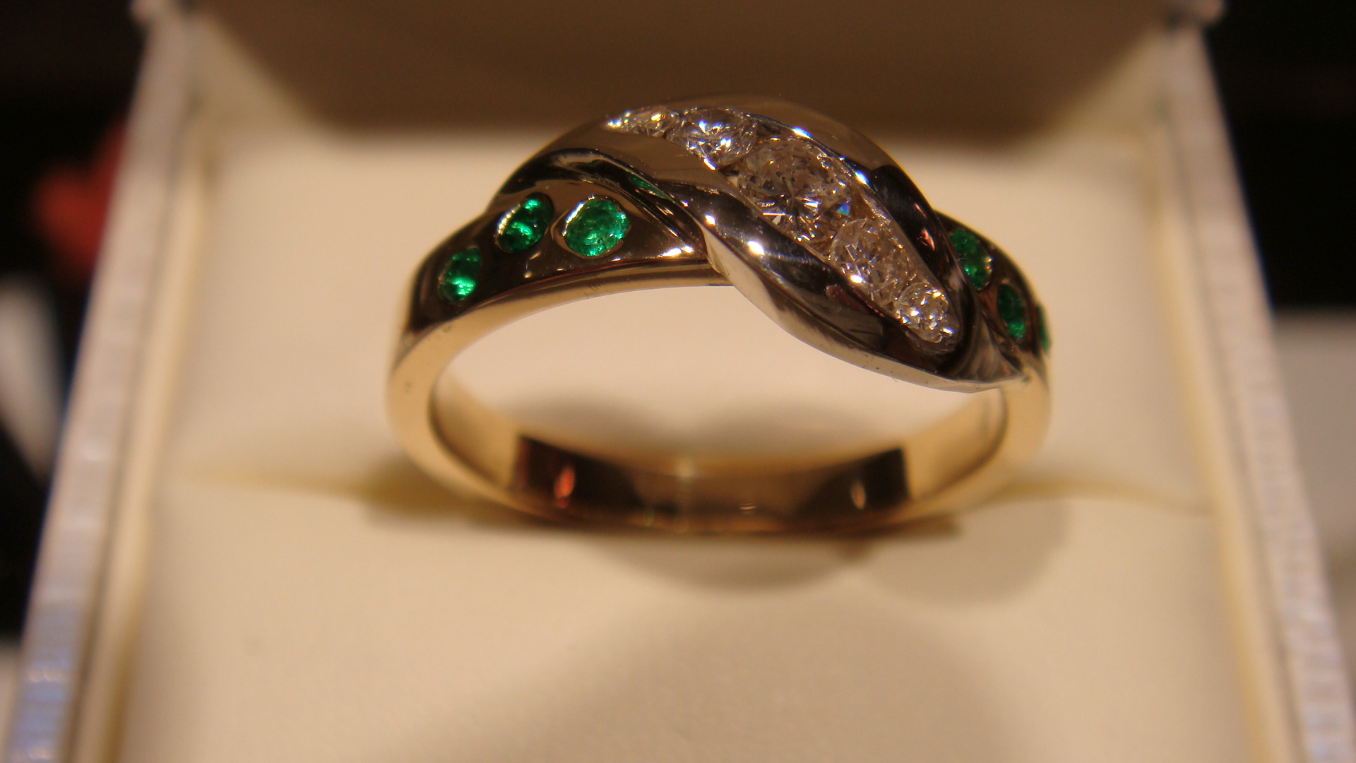 Diamonds with emeralds in 14kw