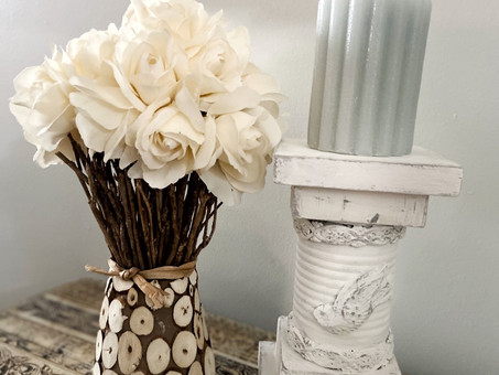 A shabby candle holder from a can and some scrap wood.