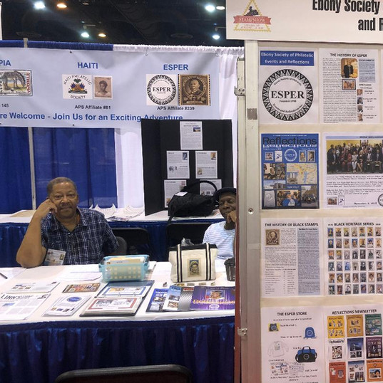 Don Neal and Clarence McKnight and the ESPER informational frame at the booth.