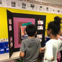 Students looking at A. Philip Randolph poster