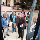 Members with Dr. Hayes getting on bus.