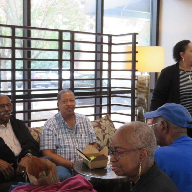 Members waiting in hotel lobby
