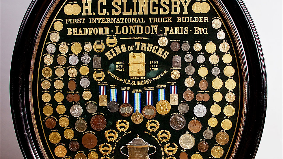 Display of medals from H.C. Slingsby Truck Company