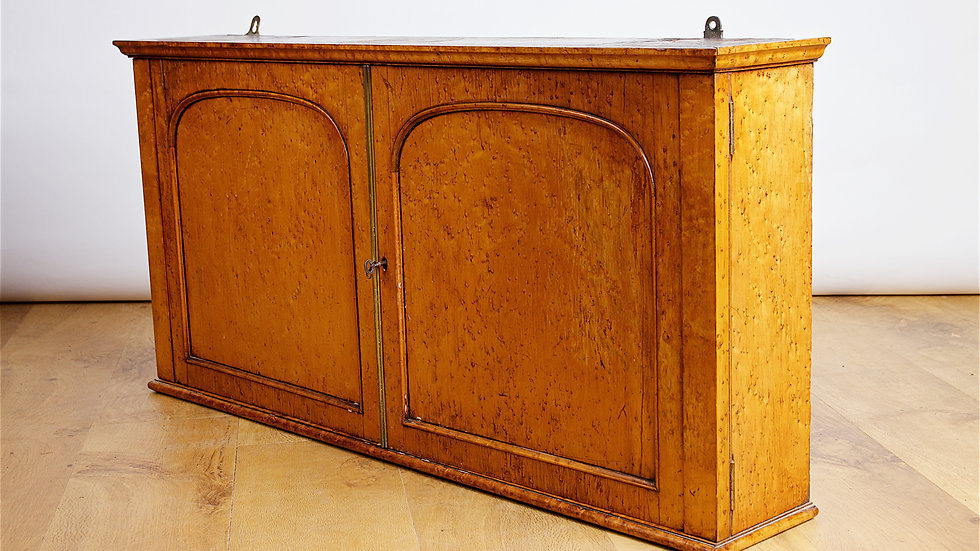 A beautiful mid 19th century birdseye Maple wall cabinet