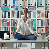 woman-practicing-meditation-on-a-desk-PV