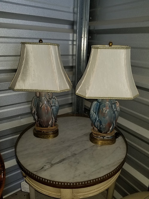 A pair of vintage glazed pottery lamps