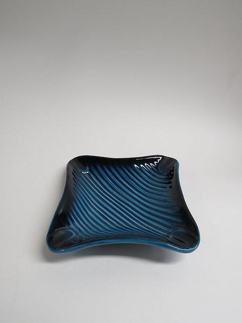 A mid century blue glazed ceramic ashtray
