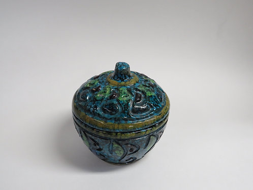 A mid century glazed pottery jar and cover italy