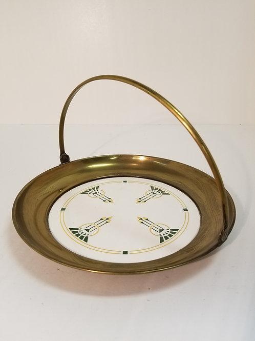 A Art Deco brass and ceramic cake tray