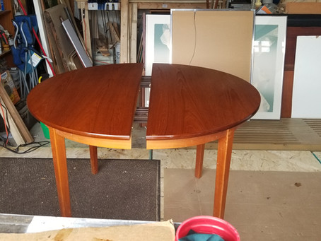 "Just finishing up this mid century teak dining table with 2 leaf's 42"" in diameter"