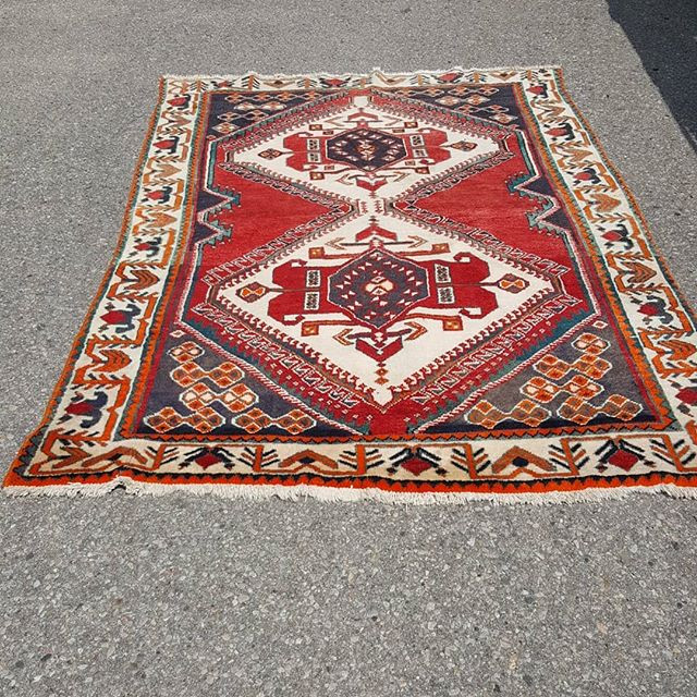 A vintage hand made oriental carpet with