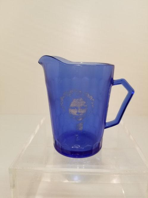 A vintage blue glass Shirley Temple jug