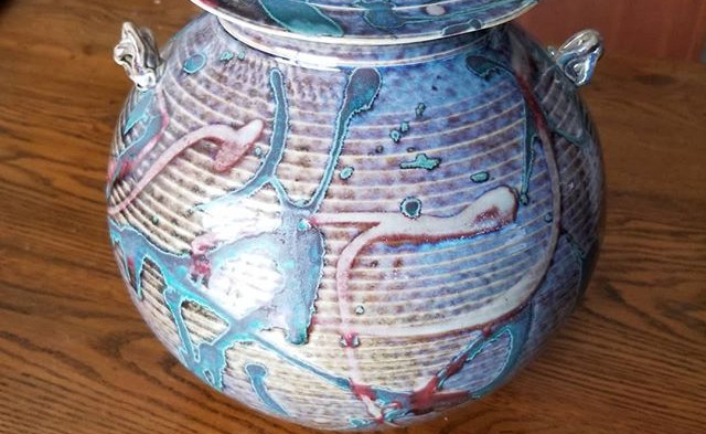A porcelain hand thrown covered jar .Sig