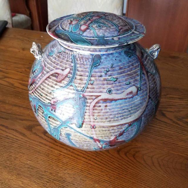 A porcelain hand thrown covered jar .Sig