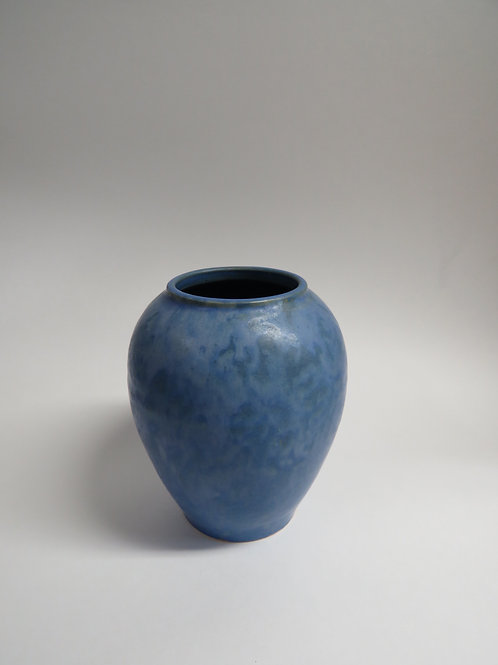 A mid century blue glazed ceramic vase